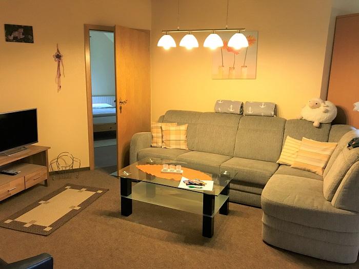 Nordsee mit Kindern - Urlaub in Friedrichskoog: Unterkunft Wohnzimmer